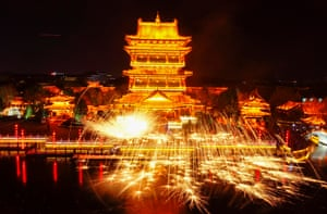 Craftsmen perform a molten iron fireworks display in Zaozhuang, China