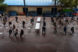 Teachers wait to be vaccinated against Covid-19 , at Abdon Cifuentes school in Santiago, Chile.