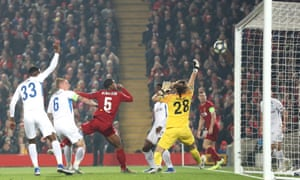 Georginio Wijnaldum hooks the ball into the roof of Genk's net to give Liverpool the lead.