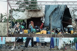 People shelter in Buzi, Mozambique, from cyclone Idai in March