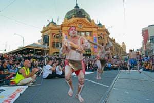 Aboriginal men in traditional costume dance as protesters stage a sit down protest outside of Flinders Street Station on May 1, 2015 in Melbourne, Australia.