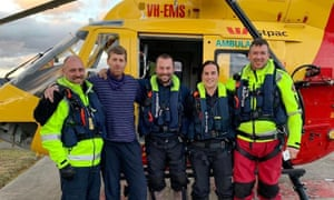Bushwalker Michael Bowman (second left) after being rescued from the Lake St Clair region in Tasmania. Bowerman had been missing in the wilderness for several days during blizzard-like conditions.