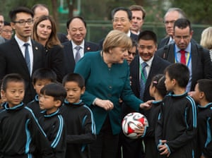 German Chancellor Angela Merkel visits China<br>epa05003214 German chancellor Angela Merkel (C) visits a physical education class in Xin Nan Cun, China, 30 October 2015. Merkel is on a two-day official visit to China. EPA/SOEREN STACHE