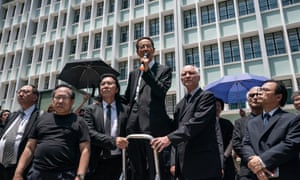 Martin Lee Chu-ming, a Hong Kong politician and barrister, speaks outside the department of justice.