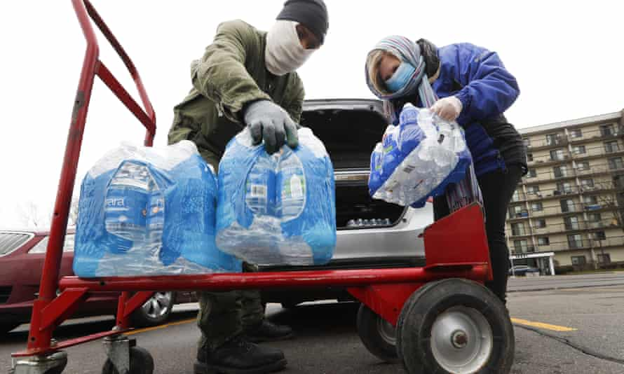 Bottled water unloaded at a food pantry in Detroit in March last year. Michigan and New York state officials are under pressure to extend their state moratoriums.