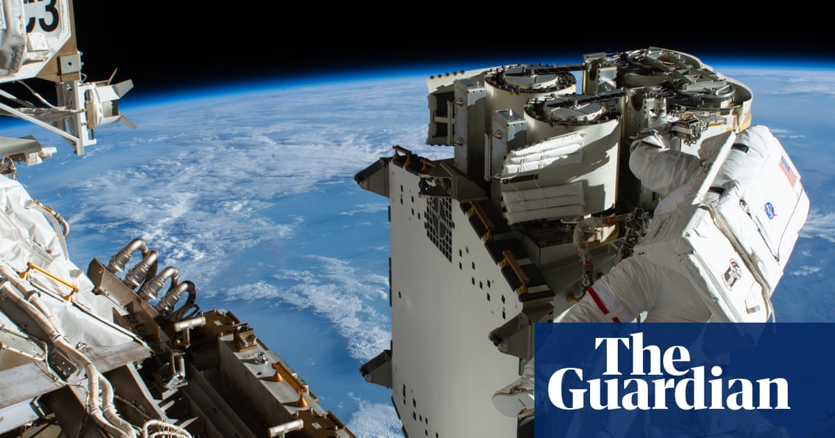 Earth emerges from shadow in Nasa time lapse of astronauts installing solar panels – video – The Guardian