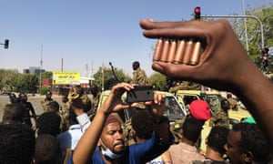 A Sudanese protester shows bullet cartridges
