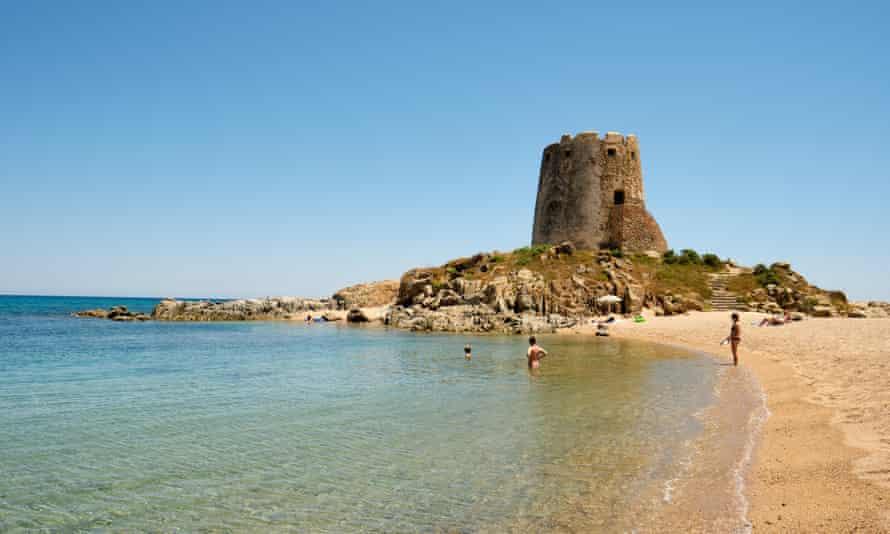Torre di Bari watchtower and beach near Barisardo Ogliastra Sardinia Italy.