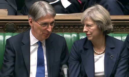 UK chancellor Phillip Hammond and prime minister Theresa May in parliament.