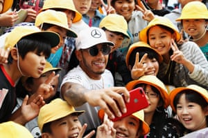 Suzuka, JapanLewis Hamilton poses with young fans ahead of the Formula One Grand Prix in Japan