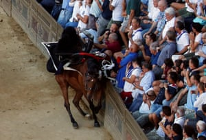 Siena, Italy Italian Carabinieri officer crashes during their parade before the fifth practices for the Palio of Siena