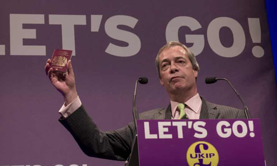 Nigel Farage holds up a British passport at the Ukip spring conference in Llandudno in February.