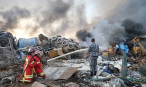 Firefighters work at the scene of the explosion