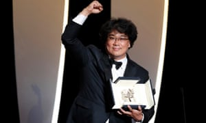 Bong Joon-ho with the Palme d'Or at Cannes, after winning for Parasite.