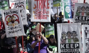 Teachers and supporters rally in front of city hall in Oakland, California, on 21 February.