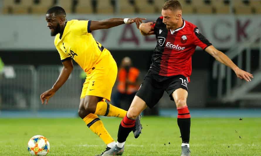 Tanguy Ndombele on the ball for Tottenham, challenged by Mevlan Murati of KF Shkendija
