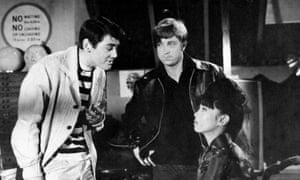 Tony Booth, left, John Forgeham and Yôko Tani in the 1963 film The Partner.