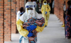 A healthcare worker carries a baby suspected to have the Ebola virus at a hospital in Oicha, in the Democratic Republic of the Congo's North Kivu province