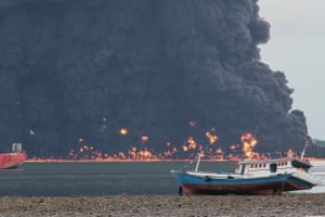 Fire rages as the oil spill spreads, igniting everything in its path