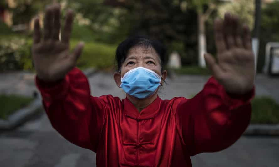 A resident wears a mask while practicing shadow boxing in Wuhan