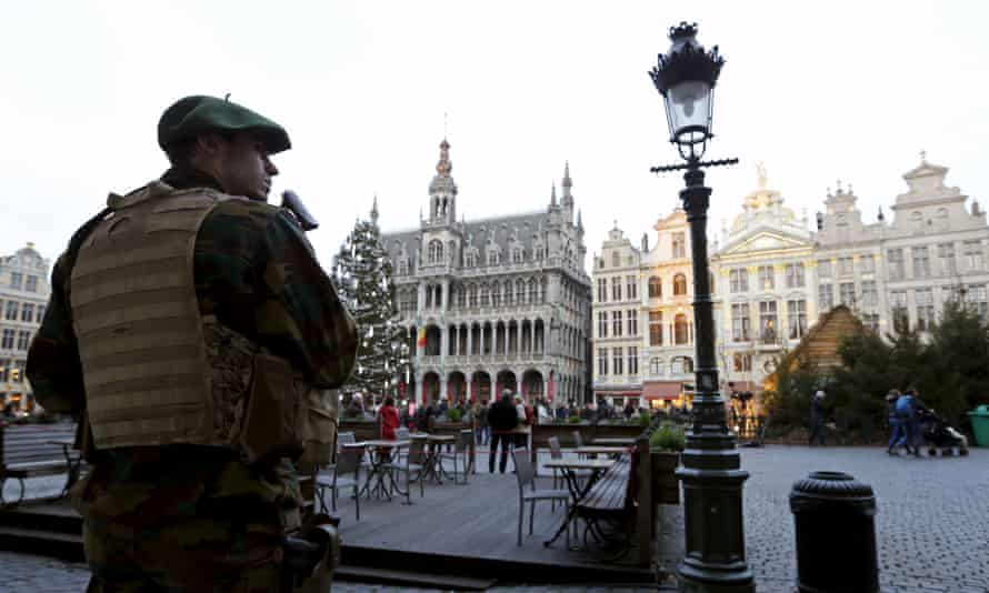 A Belgian soldier patrols on Brussels' Grand Place