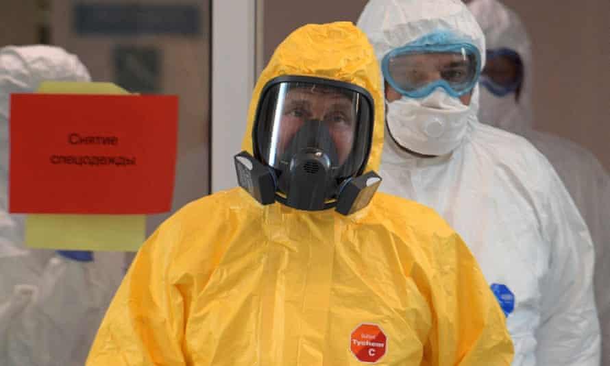 Vladimir Putin wearing a yellow hazmat suit inspecting Moscow's main coronavirus hospital in March.
