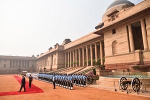 Donald Trump reviews a guard of honour during a ceremonial reception at Rashtrapati Bhavan.