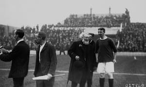 Arthur Kinnaird talks to a football player during a match, circa 1910