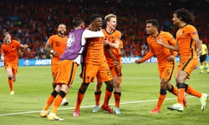 Denzel Dumfries (centre) of the Netherlands celebrates with team mates after scoring their third goal.