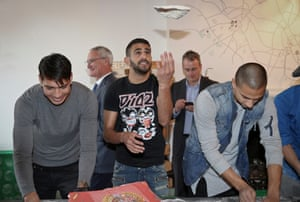 Riyad Mahrez makes a dough base during the team's visit to Peter Pizza in Leicester