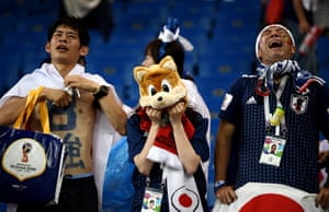 Japan fans despair at the final whistle.