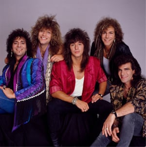 """Bon Jovi during a promo session for their third album Slippery When Wet in July 1986. During this shoot, they were shown the cover art which they hated and demanded be changed from an """"unimaginative photograph"""" to a wet car windshield. It went on to be a huge hit."""