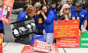 Protesters outside Melbourne's county court where Cardinal George Pell was sentenced to six years in jail for child sexual abuse