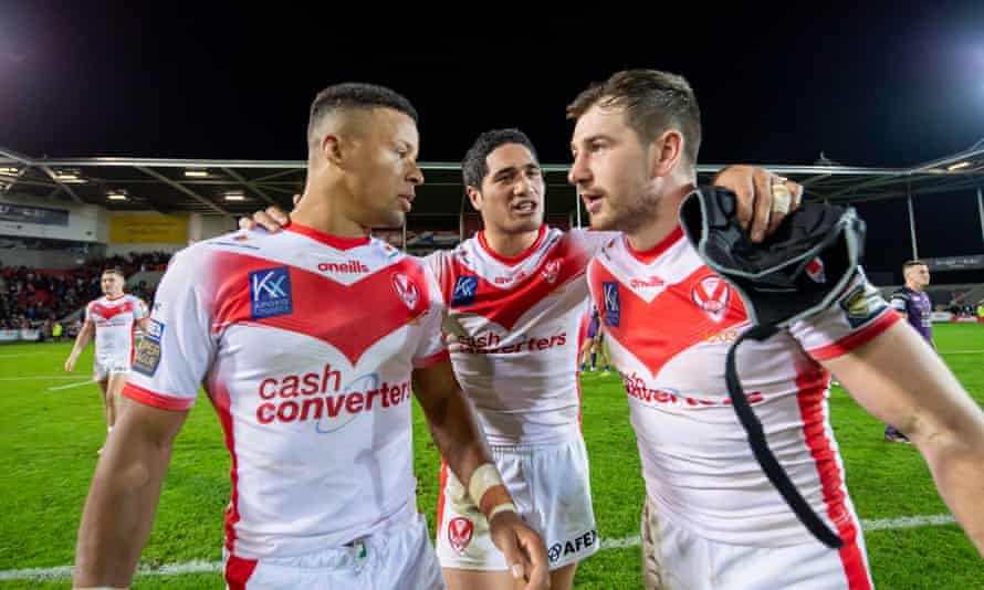 St Helens's Regan Grace, Sione Mata'utia & Mark Percival celebrate after beating Leeds to reach the Grand Final