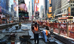 Workers on a construction site in Times Square, New York. A jump in new construction jobs contributed to the 313,000 jobs that were created in the US in February