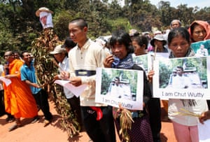 People march to the killing site of Cambodian anti-logging activist Chut Wutty in Koh Kong province in 2012.