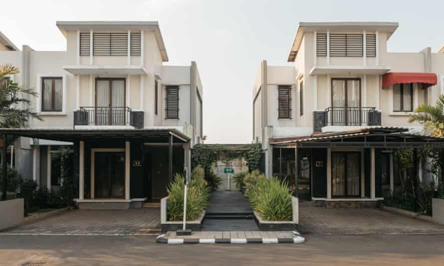 Cosmo Park is a complex of neat, two-storey homes built on top of a car park.