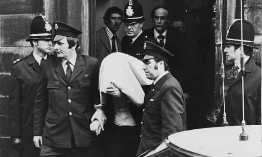 Peter Sutcliffe is escorted from Dewsbury town hall in 1981.