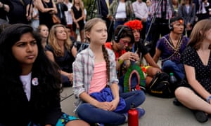 Thunberg listens to speakers during a climate change demonstration at the US supreme court in Washington DC on Wednesday.