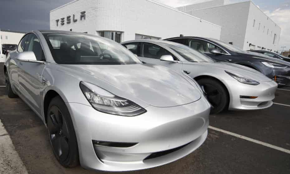 Deliveries of Tesla's Model 3 sedan, such as these outside a Tesla showroom in Littleton, Colorado, were less than expected.