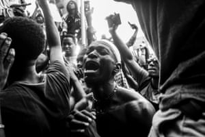 A protester cries out in a large crowd, Lekki toll gate, Lagos, Nigeria