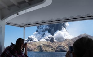 The volcano on New Zealand's White Island spews steam and ash moments after it erupted.