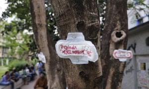 A protest written on a sanitary napkin found in Kolkata, India, reading 'menstruation is not an illness'.