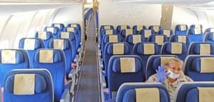 Zurich, Switzerland A Cuban passenger waits for the departure of Swiss Edelweiss' last flight to Havana in Cuba.