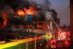 Firefighters try to control the blaze in a building close to Lima's city centre.