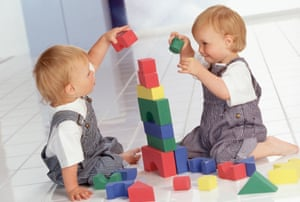 Twins playing with blocks