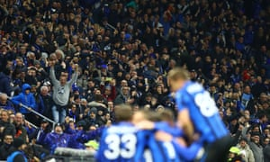 Fans celebrate as Atalanta score in the match in Bergamo, Italy, on 19 February.