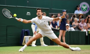 Novak Djokovic stretches for a return.