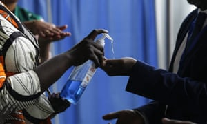 People arriving at the African Union headquarters in Addis Ababa are given disinfectant