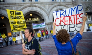 Trump protesters and supporters rally in front of the Trump International Hotel on Pennsylvania Avenue in Washington DC.